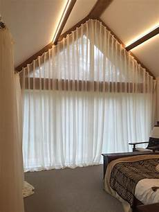 picking out window coverings for the bedroom a great idea for dressing a large apex window soft voile