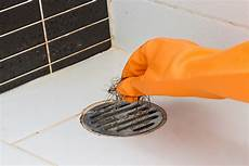 unclogging a shower drain by