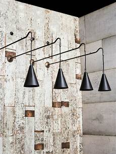 brass wall light with hanging braided cable drop and filament ls perfect for an over bar