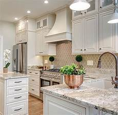 a neutral colored kitchen looks clean and fresh the patterned backsplash doesnt overpower the