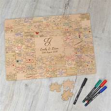 introducing the book of beautiful personalised wooden wedding jigsaw puzzle guestbook