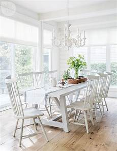 white trestle dining table with white windsor dining chairs cottage dining room