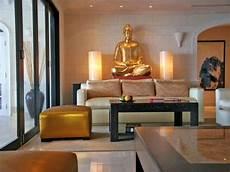 Zen Home Decor Ideas by Zen Living Room With Gold Buddha Statue Decor