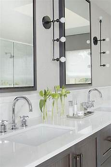 gray wash double washstand with industrial 4 light linear wall sconces transitional bathroom