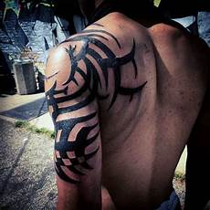 Tribal Arm - 75 tribal arm tattoos for interwoven line design ideas