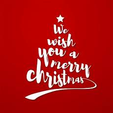 we wish you a merry christmas quote calligraphic text makes the shape of a christmas tree with a