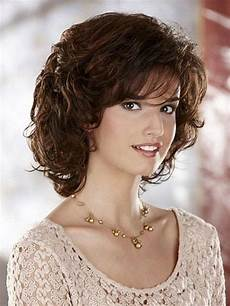cute hairstyles with bangs for medium length curly hair bombshell salon