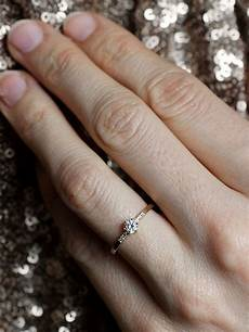 why this woman is defending her 1 4 carat engagement ring