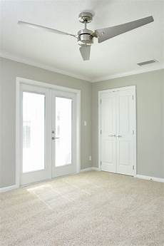 neutral shimmery gray walls with clean white trim double doors stainless steel three