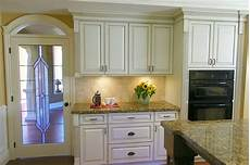 antiqued kitchen cabinets traditional kitchen vancouver by jil interiors