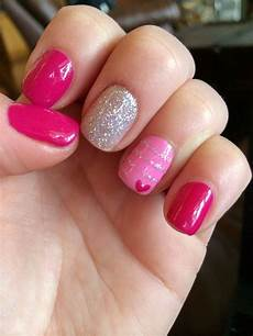 valentine s day gel manicure with heart and stripe design