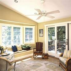 comfy sunroom interior nuance with gold wall paint color and excellent bay window and classic
