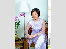 Malay Woman In Purple Lace Dress And Long Skirt Stock