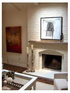 painting the brick fireplace the same color as the walls will totally change the of the