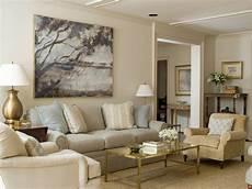 yellow beige chair slight butterscotch undertone sisal carpet green gray sofa and green beige