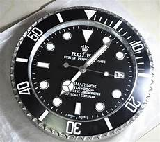 rolex submariner wall clock in city of