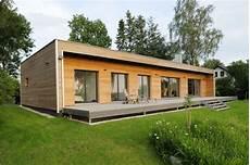 Holz Fertighaus Bungalow - holz bungalow bau fritz mit seezugang architects