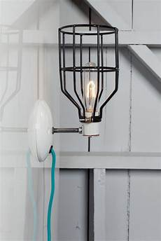 industrial wall sconce black wire cage light plug in industrial light electric