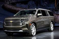 how do cars engines work 2013 chevrolet tahoe parking system gm doubling down on big suvs unveils longer chevy tahoe suburban carandbike