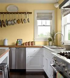 kitchen pale yellow wall color with white kitchen cabinet for country styled kitchen ideas with