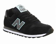 new balance ml373 trainers in black lyst