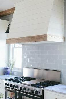 white ceiling fan subway kitchen backsplash ideas the white wood trim also the tile blue