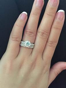 new does wedding band go on before engagement ring