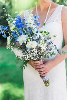 blue and white wedding bouquet by stemm floral