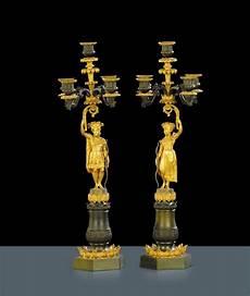 candelieri antichi coppia di candelieri impero a cinque in bronzo dorato