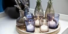 bicchieri per candele dalani centrotavola con candele per i dettagli