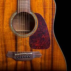 top acoustic guitars solid wood guitars why they are better