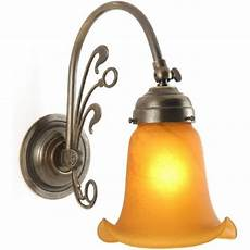 replica victorian wall light in aged brass with glass shade