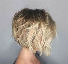 short angled bob blonde hair picture of a short angled bob with a dark root and a shaggy touch looks very dimensional
