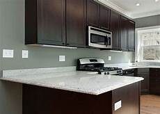 what color paint goes with cherry cabinets search man cave bar white granite