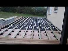 montage terrasse bois 42m 178 en pin marron sur plots