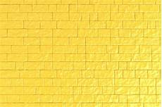 a yellow brick wall photo premium download