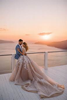 an all white wedding against the santorini sunset wedded wonderland