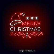 neon merry christmas with santa hat vector free download