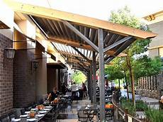 commercial louvered patio cover like the metal posts and frame ideas for the house in