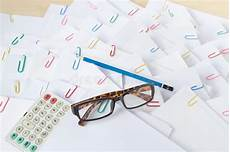 blue pencil in front of pile of overload paperwork stock image image of white receipt 63823773