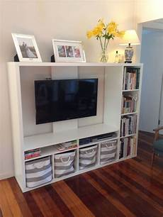 ikea lapland tv unit with books and storage baskets tv
