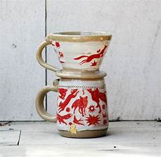 coffee pour over of handmade wheel thrown pottery mug and cone glazed in a rustic modern