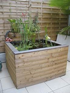 un bassin de jardin d 233 co hors sol en bois
