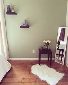 zen style bedroom green wall paint buddha accessory white roses my home decor