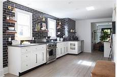 Black Backsplash Kitchen White Kitchen With Gray Quartz Countertops And Glossy