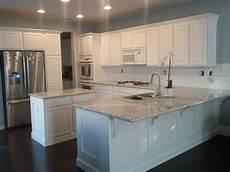 my new kitchen river white granite benjamin white dove paint subway tile back splash