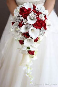 2018 high end custom holding bouquet of white calla