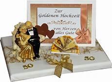 geldgeschenk zur goldenen hochzeit goldpaar sitzend