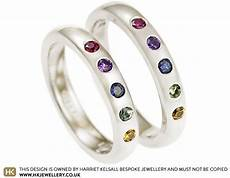 s fairtrade white gold ruby and multicoloured sapphire wedding ring
