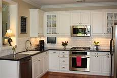 Kitchen Backsplash Black Countertop by White Cabinet Feat Black Countertop Design For Small L